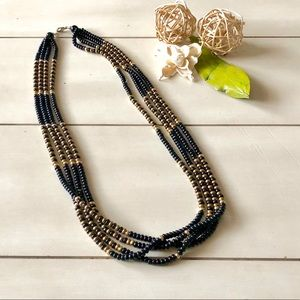 Four strand black and gold necklace